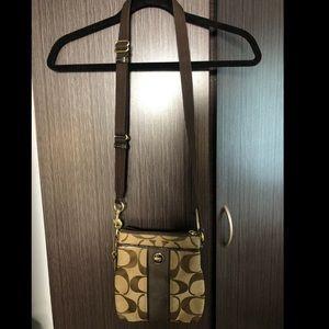 Brown/neutral Coach crossbody purse